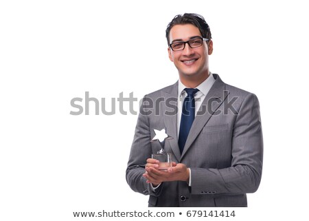businessman holding star award in business concept stock photo © elnur