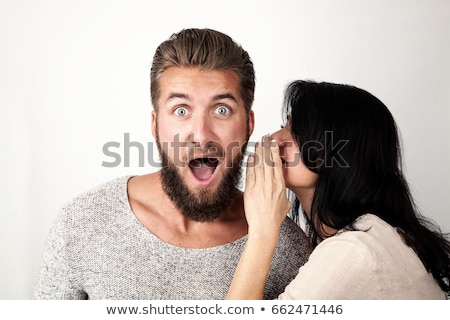 Woman whispering into man ear at office Stock photo © Giulio_Fornasar