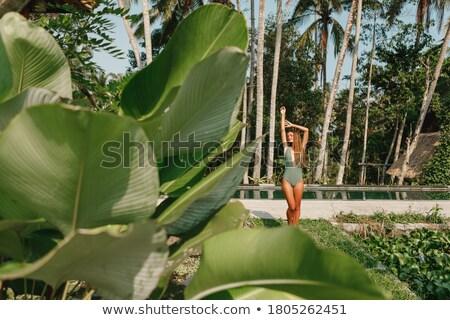 Bela mulher verde biquíni relaxante estância termal Foto stock © wavebreak_media