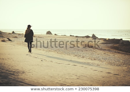 Woman walking in water at beach Stock photo © IS2