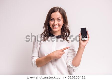 portré · derűs · boldog · lány · tart · mobiltelefon · másfelé · néz - stock fotó © deandrobot