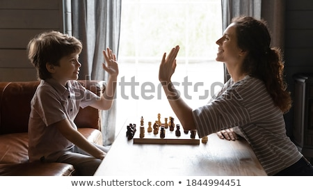 Young woman in small room with chess set Stock photo © IS2
