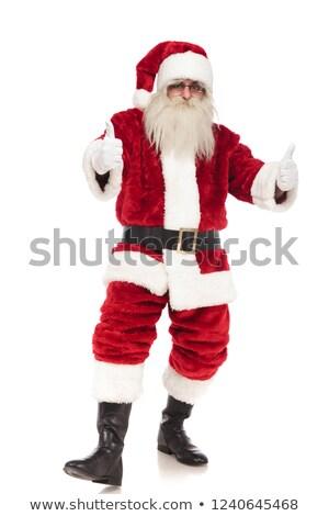 merry saint nick makes ok sign while standing Stock photo © feedough