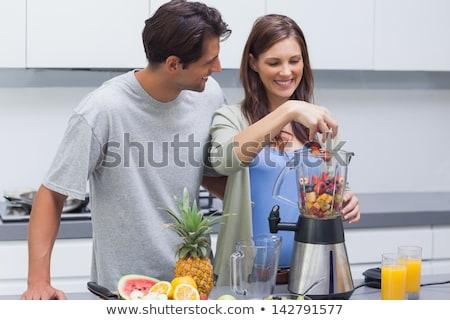 happy woman making fruit juice or orange fresh Stock photo © dolgachov