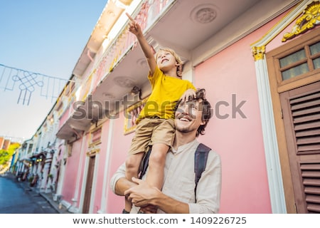 Dad and son are tourists on the Street in the Portugese style Romani in Phuket Town. Also called Chi Stock photo © galitskaya