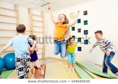kids enjoying physical education class gym class for children stock photo © matimix