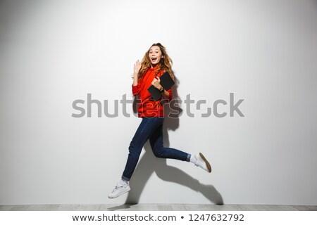 Horizontal image of adorable woman 20s wearing red sweatshirt wa Stock photo © deandrobot