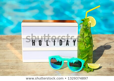 Light letterbox with word Holiday, hat, sunglasses and Mojito co Stock photo © dashapetrenko