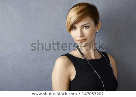 Fotoğraf 20s siyah elbise gülen Stok fotoğraf © deandrobot