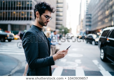 Image of stylish businessman in formal wear, crossing avenue in  Stock photo © deandrobot
