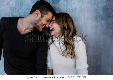 young happy loving couple hugging stock photo © deandrobot