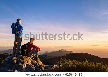 Couple Enjoying Panoramic Mountain View Stock photo © AndreyPopov