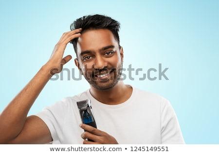 Mosolyog indiai férfi körülvágó megérint haj Stock fotó © dolgachov