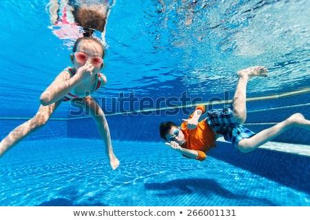 笑みを浮かべて · 少年 · 女の子 · スイミングプール · アクアパーク · 水 - ストックフォト © galitskaya