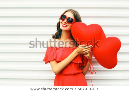happy young woman with red heart shaped balloons stock photo © dolgachov