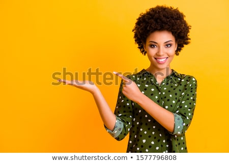 Portrait of smiling multinational women pointing fingers at camera Stock photo © deandrobot