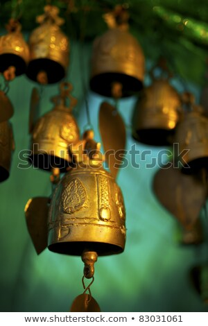 buddhist bells inside the temple vertical shot stock photo © moses