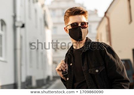 portré · jóképű · fiatalember · napszemüveg · izolált · fekete - stock fotó © leeser