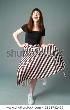 Beautiful Brunette Balancing On One Foot Stock photo © stryjek