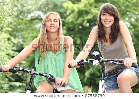 jovens · equitação · bicicletas · floresta · paisagem · casal - foto stock © photography33