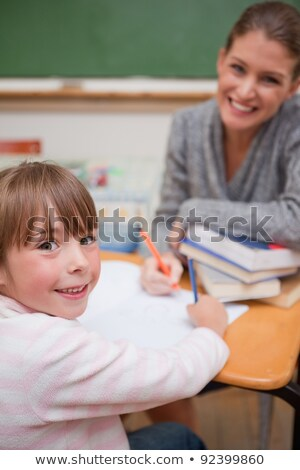 Portrait of teacher helping young student with her studies in co Stock photo © HASLOO