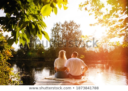 couple sitting by a lake stock photo © photography33