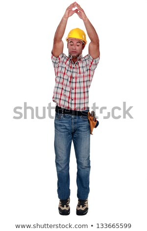 Tradesman raising his arms over his head Stock photo © photography33