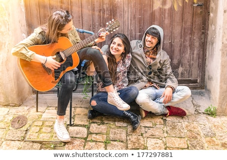 Three teenager playing musical instruments Stock photo © photography33