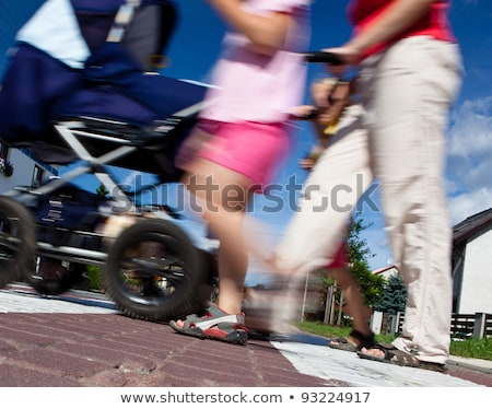 mother with small children and a pram crossing a street Stock photo © lightpoet