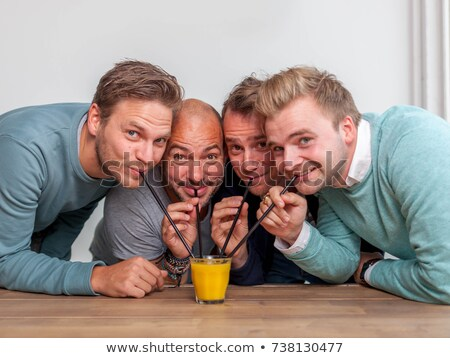 couple drinking orange juice from the same glass with straws Stock photo © photography33