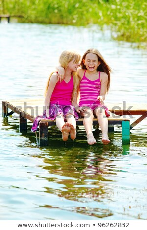 Two Teenager Girls Laughing And Giggling Stock photo © stuartmiles