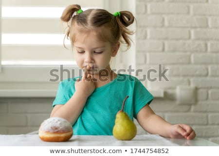 little girl choosing between apple and pear stock photo © photography33