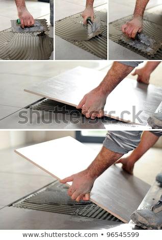 Klusjesman lijm vloer hand keuken salon Stockfoto © photography33