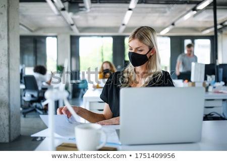 trabalhando · escritório · feminino · estilista · sorridente · câmera - foto stock © photography33