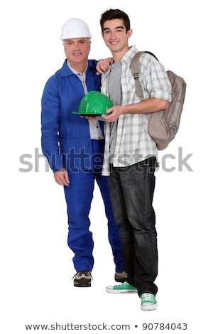 Stock photo: Experienced tradesman posing with his new apprentice