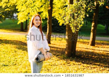 genç · kadın · ayakta · park · mutlu · kış · portre - stok fotoğraf © hangingpixels