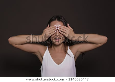 young woman covering her face with her hand Stock photo © feedough