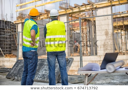 Working in a green jacket at a construction site Stock photo © RuslanOmega