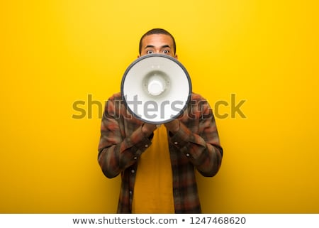 African man shouting through a megaphone Stock photo © photography33