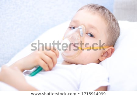 sick little boy lying in a hospital bed stock photo © wavebreak_media