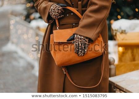 cheerful woman wearing leopard coat stock photo © acidgrey