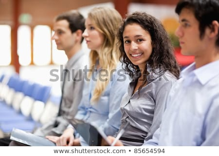 Young businesswoman smiling at the camera during a presentation Stock photo © wavebreak_media