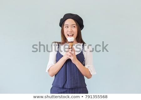 atrakcyjny · młoda · kobieta · jedzenie · pączek · różowy · młodych - zdjęcia stock © stryjek