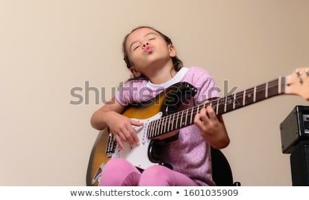 Pretty girl with electric guitar Stock photo © Aikon