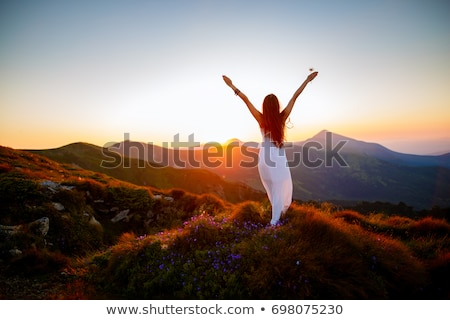 fashion woman stands with hands up Stock photo © feedough