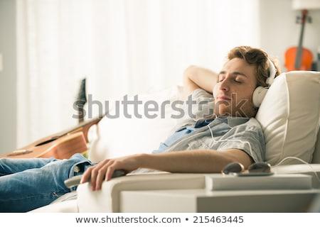 homme · couché · canapé · détente · sourire · garçon - photo stock © HASLOO