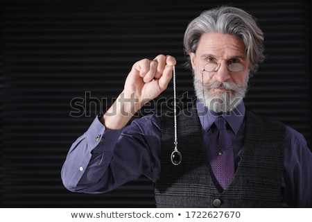portrait of professional hypnotist on black background stock photo © hasloo