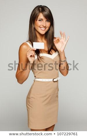 Summer Dress Woman Holding Sign stock photo © eldadcarin