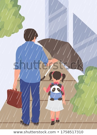 girl with an umbrella in the rain with his father stock photo © koca777