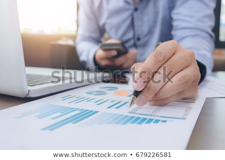 Businessman doing the numbers stock photo © Rugdal
